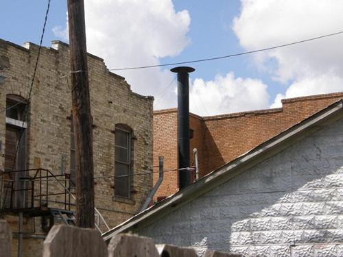 Shiner Texas bricks, wood, cement , pipes, wire, clouds