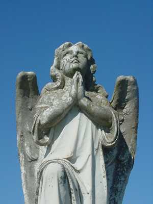Praying Angel statue in Warda Texas Cemetery