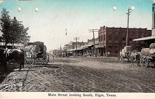 Cotton wagons on Main Street looking South, Elgin Texas