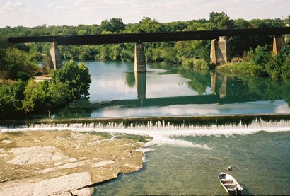View of Guadalupe River and RR Bridge in  New Braunfels TX
