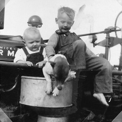 Rosebud TX - Robert and Henry Skupin On Tractor with dog Max